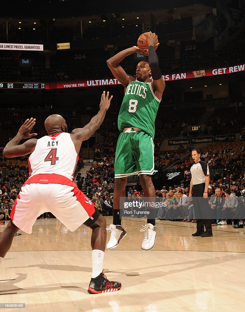 Jeff Green #8 of the Boston Celtics shoots against <a gi-track='captionPersonalityLinkClicked' href=/galleries/search?phrase=Quincy+Acy&family=editorial&specificpeople=5674079 ng-click='$event.stopPropagation()'>Quincy Acy</a> #4 of the Toronto Raptorsduring the game on October 16, 2013 at the Air Canada Centre in Toronto, Ontario, Canada.