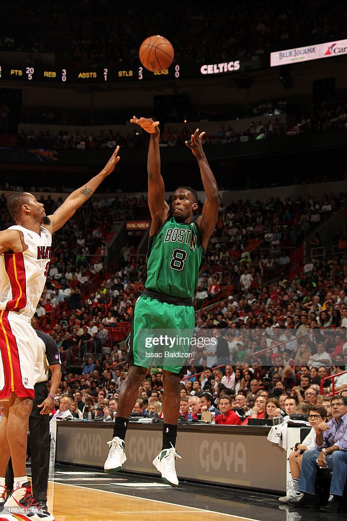 Jeff Green #8 of the Boston Celtics shoots against <a gi-track='captionPersonalityLinkClicked' href=/galleries/search?phrase=Rashard+Lewis&family=editorial&specificpeople=201713 ng-click='$event.stopPropagation()'>Rashard Lewis</a> #9 of the Miami Heat on April 12, 2013 at American Airlines Arena in Miami, Florida.