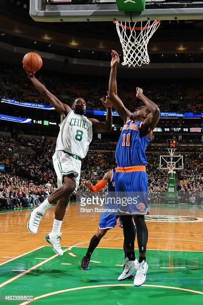Jeff Green of the Boston Celtics shoots against Samuel Dalembert of the New York Knicks on December 12 2014 at the TD Garden in Boston Massachusetts...