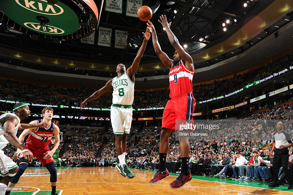Jeff Green #8 of the Boston Celtics tries to block the shot against Martell Webster #9 of the Washington Wizards on April 7, 2013 at the TD Garden in Boston, Massachusetts.