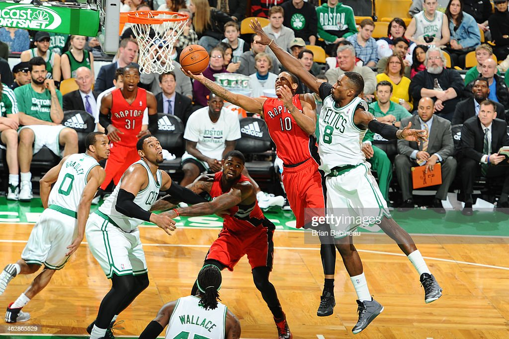 Jeff Green #8 of the Boston Celtics tries to block the shot against DeMar DeRozan #10 of the Toronto Raptors on January 15, 2014 at the TD Garden in Boston, Massachusetts.