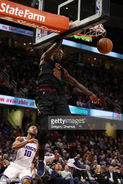 Jeff Green of the Cleveland Cavaliers dunks in front of Frank Mason III of the Sacramento Kings during the second half at Quicken Loans Arena on...