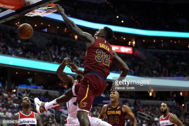 Jeff Green of the Cleveland Cavaliers dunks over Ian Mahinmi of the Washington Wizards in the first half during a preseason game at Capital One Arena...