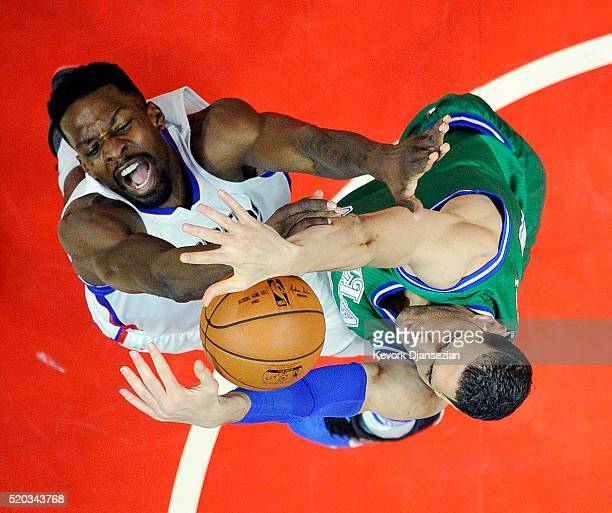 Jeff Green of the Los Angeles Clippers has his layup blocked by Salah Mejri of the Dallas Mavericks during the first half of the basketball game at...