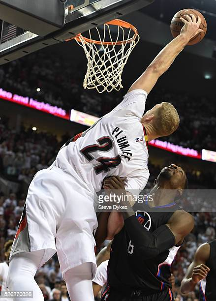 Jeff Green of the Los Angeles Clippers is called for a loose ball foul on Mason Plumlee of the Portland Trail Blazers late in the fourth quarter of...