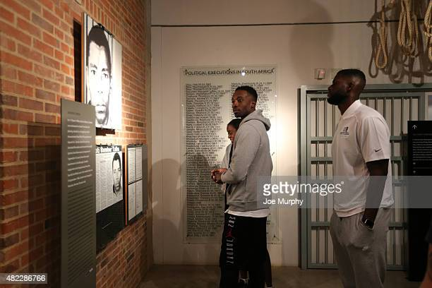 Jeff Green of the Memphis Grizzlies and Nazr Mohammed of the Chicago Bulls takes in the exhibit during the Basketball Without Boarders program on...