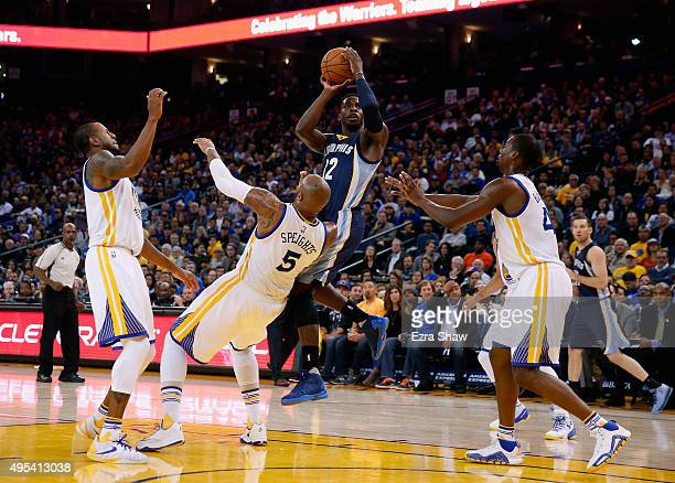 Jeff Green of the Memphis Grizzlies goes up for a shot against Marreese Speights Andre Iguodala and Harrison Barnes of the Golden State Warriors at...