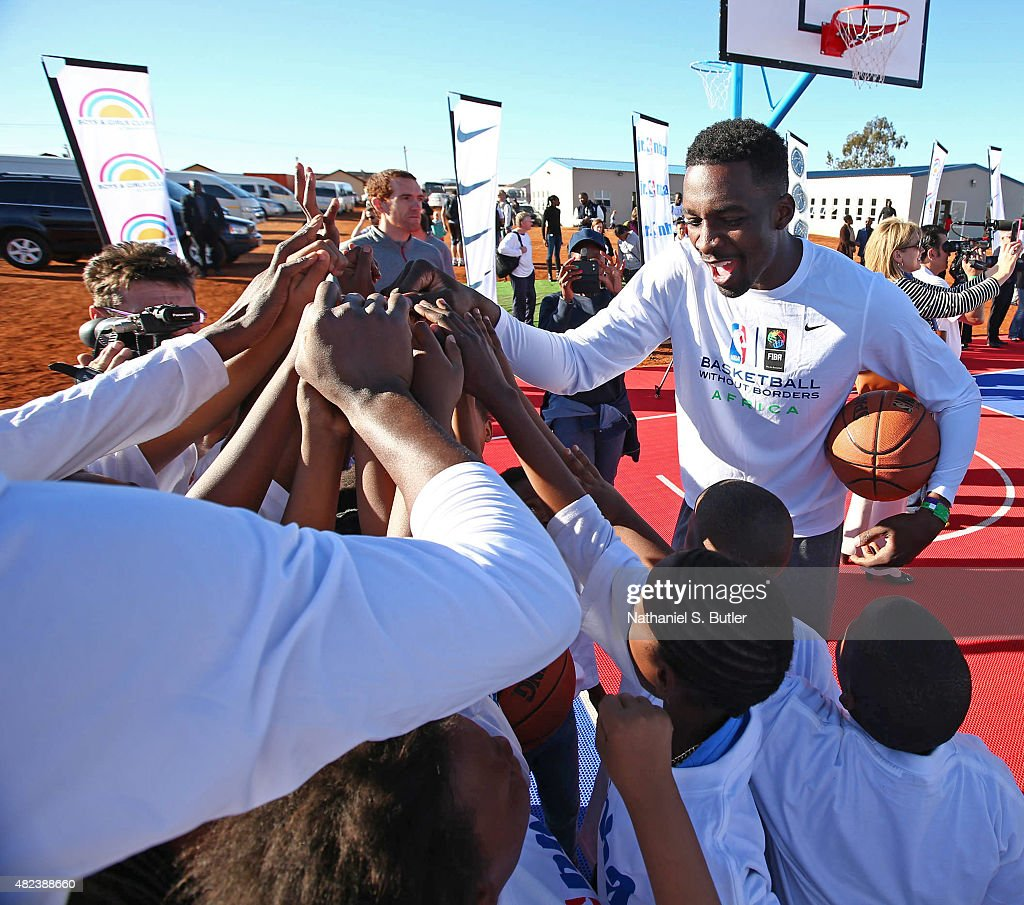 <a gi-track='captionPersonalityLinkClicked' href=/galleries/search?phrase=Jeff+Green+-+Basket&family=editorial&specificpeople=4218745 ng-click='$event.stopPropagation()'>Jeff Green</a> #32 of the Memphis Grizzlies huddles kids up during the Boys & Girls Club of Protea Glen court dedication as part the Basketball Without Boarders program on July 30, 2015 at the Protea Glen Clubhouse in Soweto, South Africa.
