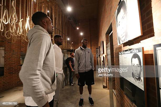Jeff Green of the Memphis Grizzlies Nazr Mohammed of the Chicago Bulls and Festus Ezeli of the Golden State Warriors takes in the exhibit during the...