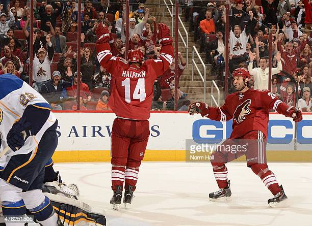 Jeff Halpern and teammate Kyle Chipchura of the Phoenix Coyotes celebrate a second period goal against the St Louis Blues at Jobingcom Arena on March...