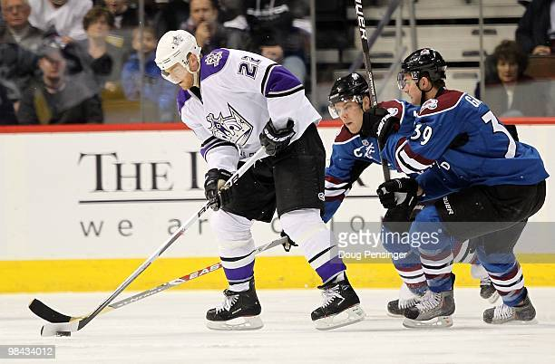Jeff Halpern of the Los Angeles Kings controls the puck against Paul Stastny and TJ Galiadi of the Colorado Avalanche during NHL action at the Pepsi...
