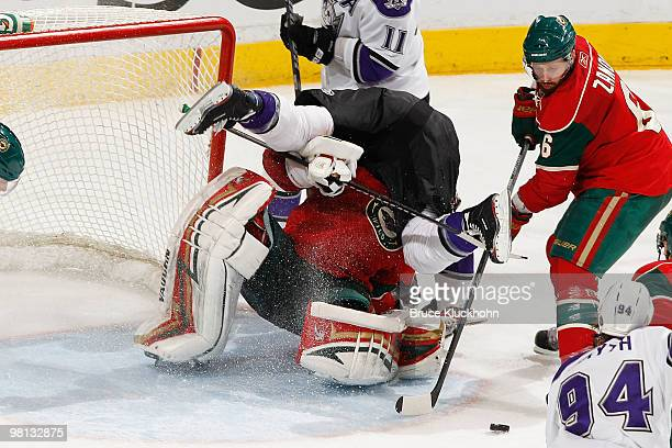 Jeff Halpern of the Los Angeles Kings is called for goalkeeper interference after colliding with Niklas Backstrom of the Minnesota Wild during the...