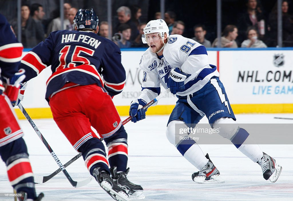 Jeff Halpern #15 of the New York Rangers defends against Steven Stamkos #91 of the Tampa Bay Lightning at Madison Square Garden on February 10, 2013 in New York City.