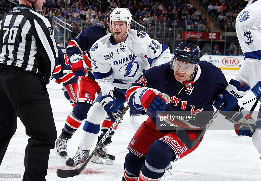 <a gi-track='captionPersonalityLinkClicked' href=/galleries/search?phrase=Jeff+Halpern&family=editorial&specificpeople=206583 ng-click='$event.stopPropagation()'>Jeff Halpern</a> #15 of the New York Rangers skates against <a gi-track='captionPersonalityLinkClicked' href=/galleries/search?phrase=Adam+Hall+-+Ice+Hockey+Player&family=editorial&specificpeople=202919 ng-click='$event.stopPropagation()'>Adam Hall</a> #18 of the Tampa Bay Lightning at Madison Square Garden on February 10, 2013 in New York City. The Rangers defeat the Lightning 5-1.