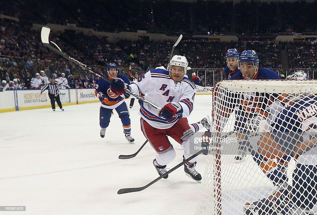 Jeff Halpern #15 of the New York Rangers skates against the New York Islanders at the Nassau Veterans Memorial Coliseum on March 7, 2013 in Uniondale, New York. The Rangers defeated the Islanders 2-1 in overtime.