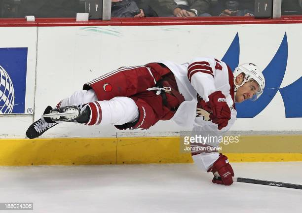 Jeff Halpern of the Phoenix Coyotes goes airborne after being checked by Bryan Bickell of the Chicago Blackhawks at the United Center on November 14...