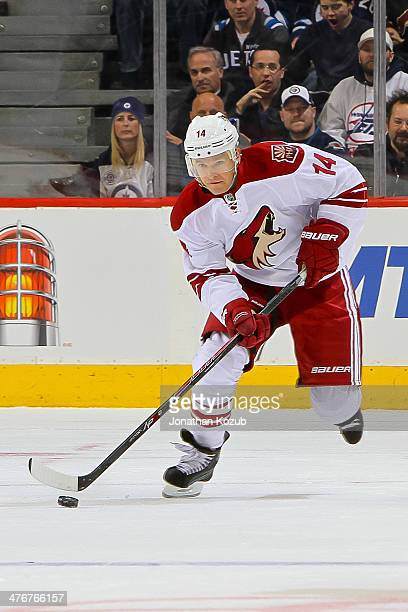 Jeff Halpern of the Phoenix Coyotes plays the puck up the ice during first period action against the Winnipeg Jets at the MTS Centre on February 27...