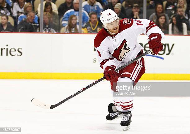 Jeff Halpern of the Phoenix Coyotes skates against the Pittsburgh Penguins during the game at Consol Energy Center on March 25 2014 in Pittsburgh...