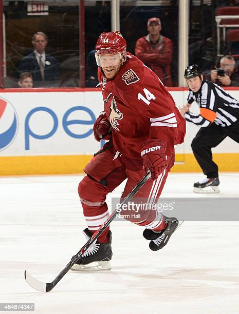 Jeff Halpern of the Phoenix Coyotes skates up ice after the puck against the Anaheim Ducks at Jobingcom Arena on January 11 2014 in Glendale Arizona