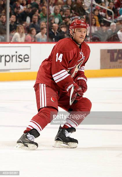 Jeff Halpern of the Phoenix Coyotes skates up ice while looking for the puck against the Anaheim Ducks at Jobingcom Arena on November 23 2013 in...