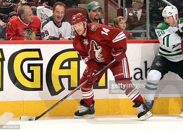 Jeff Halpern of the Phoenix Coyotes skates with the puck against the Dallas Stars at Jobingcom Arena on April 13 2014 in Glendale Arizona