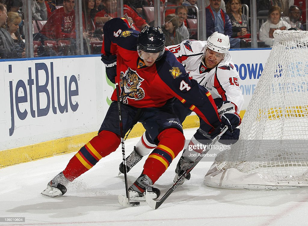 Jeff Halpern #15 of the Washington Capitals attempts to check the puck away from Keaton Ellerby #4 of the Florida Panthers on February 17, 2012 at the BankAtlantic Center in Sunrise, Florida.