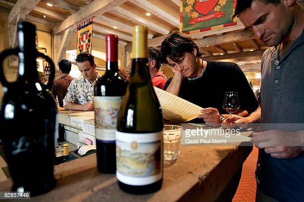 Jeff Hamaoui and Alex Prince look over a wine tasting menu at the Vianasa Winery May 16 2005 in Napa Valley California The Supreme court voted to...