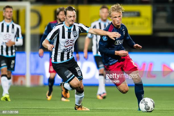 Jeff Hardeveld of Heracles Almelo Kasper Dolberg of Ajax during the Dutch Eredivisie match between Heracles Almelo and Ajax Amsterdam at Polman...