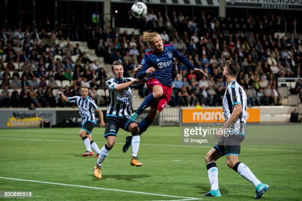 Jeff Hardeveld of Heracles Almelo Kasper Dolberg of Ajax Robin Propper of Heracles Almelo during the Dutch Eredivisie match between Heracles Almelo...