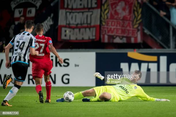 Jeff Hardeveld of Heracles Almelo Luciano Slagveer of FC Twente goalkeeper Bram Castro of Heracles Almelo during the Dutch Eredivisie match between...