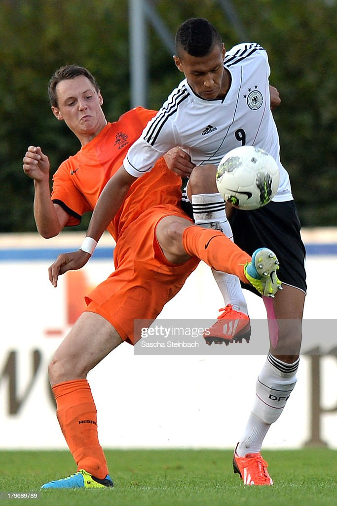 Jeff Hardeveld of The Netherlands and Davie Selke (R) of Germany compete for the ball during the U19 international friendly match between The Netherlands and Germany on September 6, 2013 in Nijmegen, Netherlands.