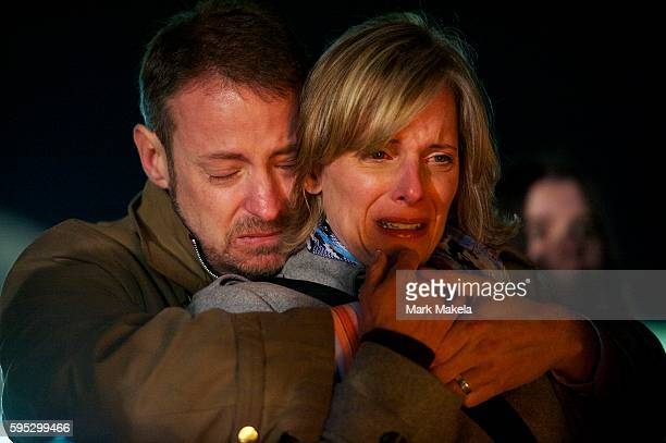Jeff Hardy and Tania Scott embrace during a prayer vigil in Stratford CT the day after a mass shooting of 20 children and 7 adults at Sandy Hook...