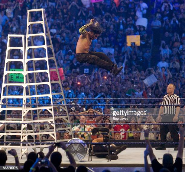 Jeff Hardy leaps off a ladder onto the body of brother Matt during an extreme rules match at 'WrestleMania 25' at the Reliant Stadium on April 5 2009...
