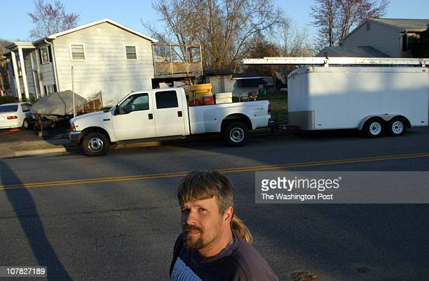 Jeff Harkema stands across the street from his house in Dale City and infront his vehicles that are still in complience with Prince William County...