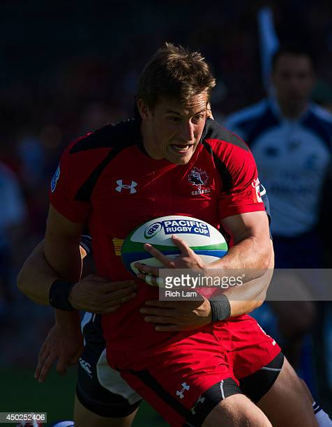 Jeff Hassler of Canada is wrapped up by Akihito Yamada of Japan during the first half in Pacific Nations Cup Rugby action on June 7 2014 at Swanguard...