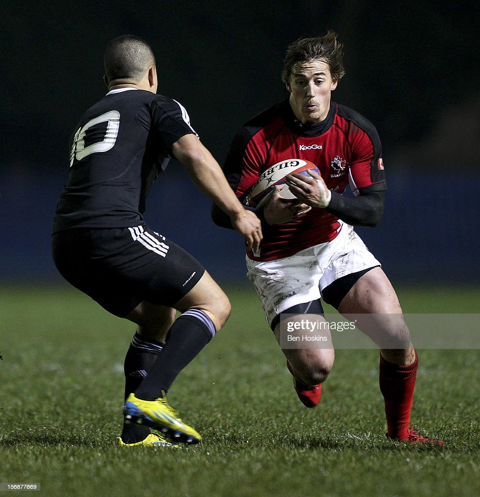 Jeff Hassler of Canada runs at Willie Ripia of the Maori All Blacks during a tour match between Canada and Maori All Blacks at Oxford University Rugby Club on November 23, 2012 in Oxford, England.