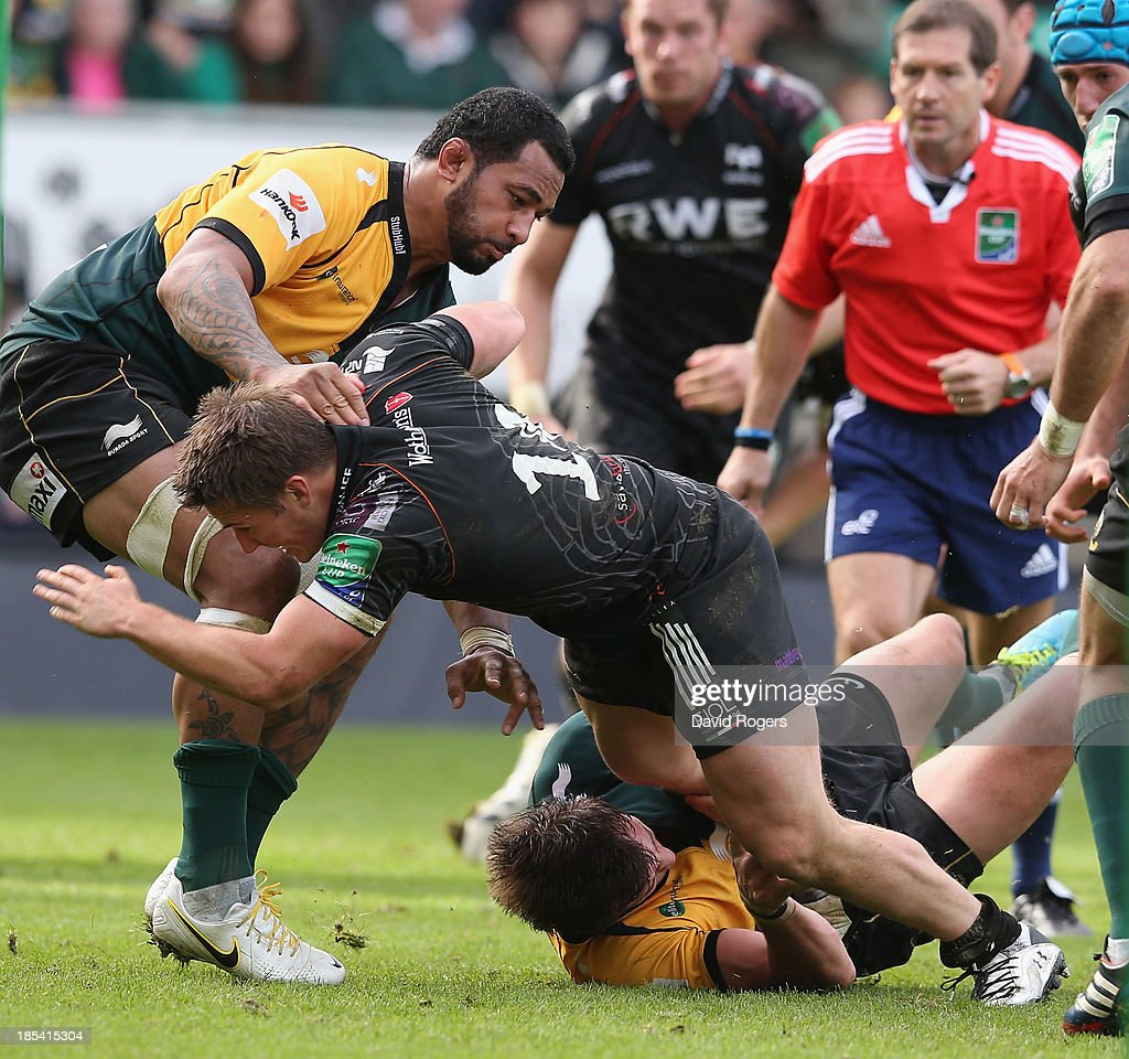 Jeff Hassler of the Ospreys is tackled by <a gi-track='captionPersonalityLinkClicked' href=/galleries/search?phrase=Samu+Manoa&family=editorial&specificpeople=8040224 ng-click='$event.stopPropagation()'>Samu Manoa</a> (L) during the Heineken Cup pool 1 match between Northampton Saints and Ospreys at Franklin's Gardens on October 20, 2013 in Northampton, England.