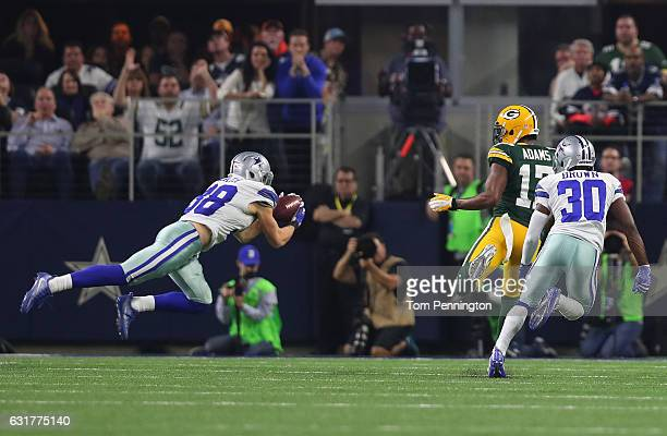 Jeff Heath of the Dallas Cowboys intercepts a pass from Aaron Rodgers of the Green Bay Packers during the third quarter in the NFC Divisional Playoff...