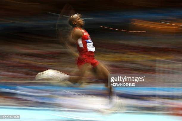 US Jeff Henderson competes in the Men Long Jump Group A event at the IAAF World Indoor Athletics Championships in the Ergo Arena in the Polish...
