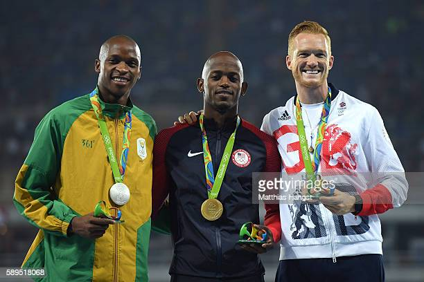 Jeff Henderson of the United States poses with the gold medal Luvo Manyonga of South Africa silver medal and Greg Rutherford of Great Britain bronze...