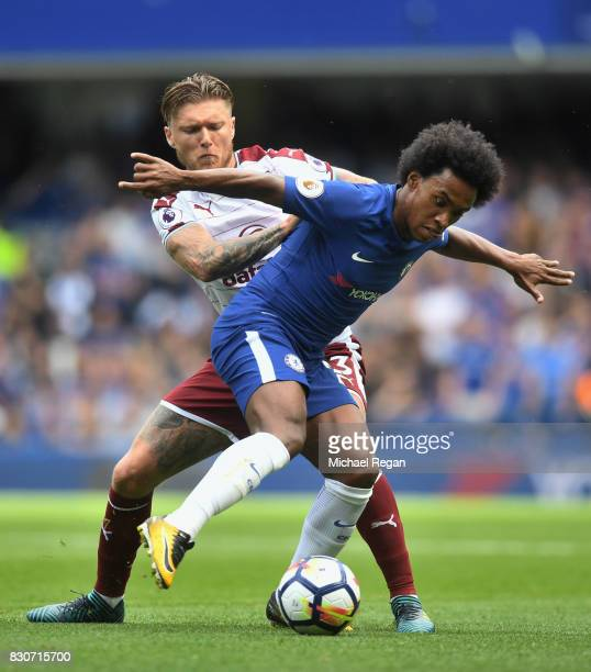 Jeff Hendrick of Burnley and Willian of Chelsea battle for possession during the Premier League match between Chelsea and Burnley at Stamford Bridge...