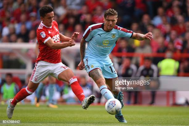 Jeff Hendrick of Burnley and Zach Clough of Nottingham Forest in action during the pre season friendly match between Nottingham Forest and Burnley at...