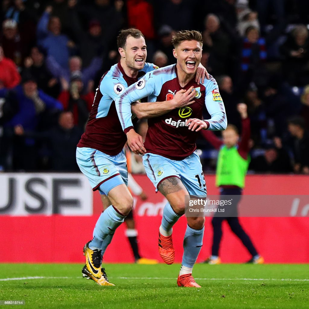 Jeff Hendrick of Burnley celebrates scoring the opening goal with team-mate Ashley Barnes during the Premier League match between Burnley and Newcastle United at Turf Moor on October 30, 2017 in Burnley, England.