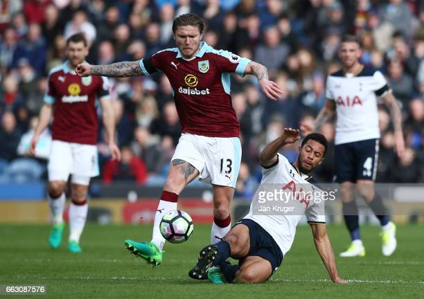 Jeff Hendrick of Burnley is tackled by Mousa Dembele of Tottenham Hotspur during the Premier League match between Burnley and Tottenham Hotspur at...