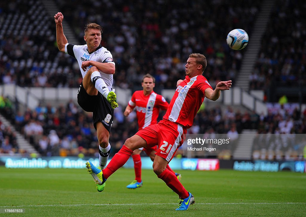Jeff Hendrick of Derby battles Alex Marrow of Blackburn during the Sky Bet Championship match between Derby County and Blackburn Rovers at Pride Park Stadium on August 04, 2013 in Derby, England,