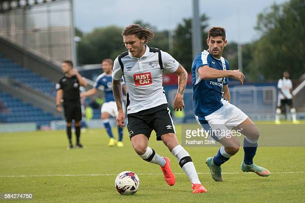 Jeff Hendrick of Derby County and Ched Evans of Chesterfield battle for the ball during the PreSeason Friendly between Chesterfield and Derby County...