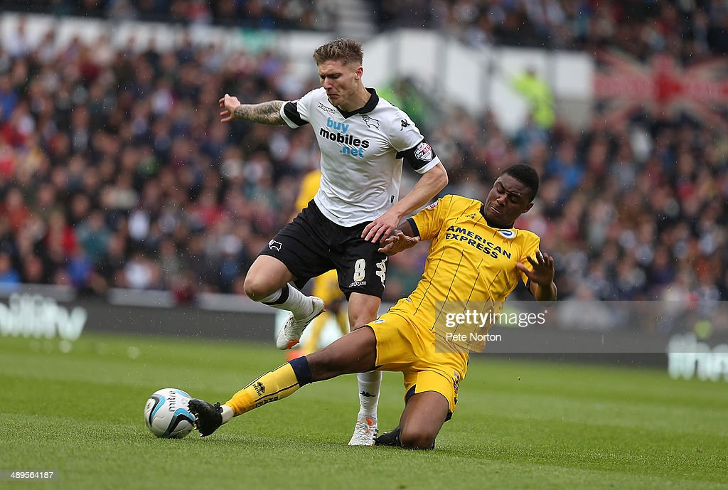 Jeff Hendrick of Derby County attempts to move away from the challenge of Rohan Ince of Brighton & Hove Albion during the Sky Bet Championship Semi Final Second Leg between Derby County and Brighton & Hove Albion at iPro Stadium on May 11, 2014 in Derby, England.