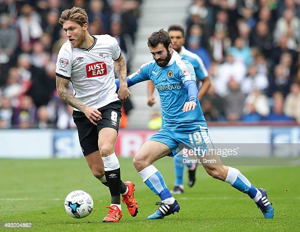 Jeff Hendrick of Derby County FC maintains control over Jack Price of Wolverhampton Wanderers FC during the Sky Bet Championship match between Derby...