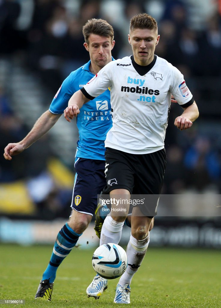 Jeff Hendrick of Derby holds off pressure from Michael Tongue of Leeds during the npower Championship match between Derby County and Leeds United at Pride Park on December 8, 2012 in Derby, England.