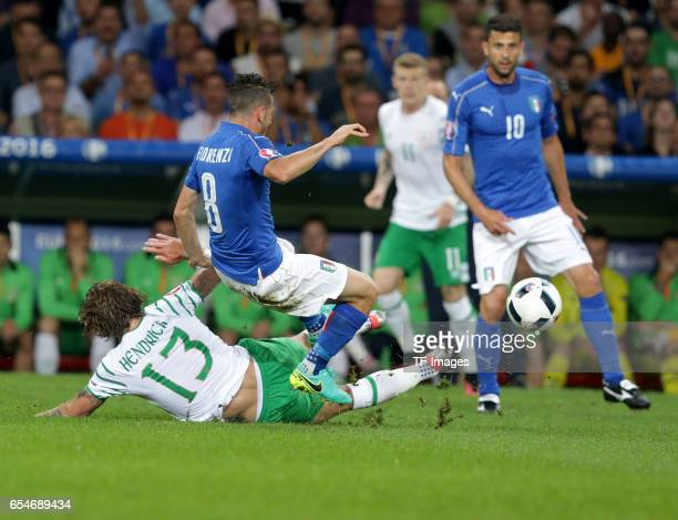 Jeff Hendrick of Ireland and Alessandro Florenzi of Italy and Thiago Motta of Italy battle for the ball during the UEFA Euro 2016 Group E match...